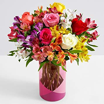 multi colored smiles and sunshine flowers with clear vase